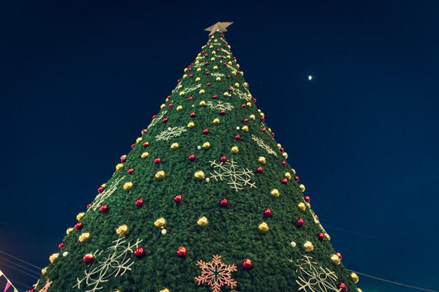 Christmas Carols,Closeup of Christmas tree and lights background